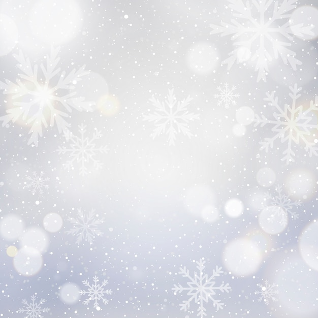 White christmas background with bokeh and snowflakes Free Vector
