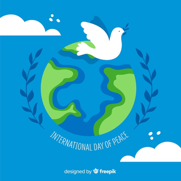 White dove on earth for peace day Free Vector