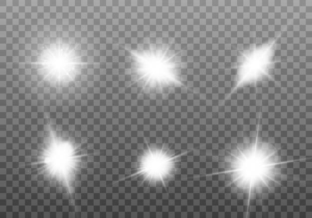 白く光る光。ブライトスターのセット。輝く太陽 Premiumベクター