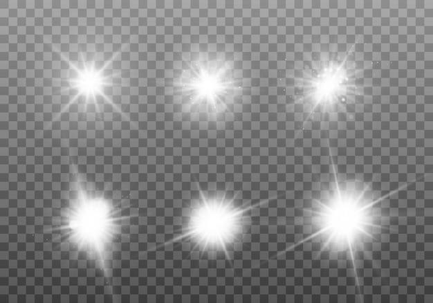 白く光る光。ブライトスターのセット。 Premiumベクター