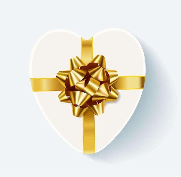 황금 활과 하얀 심장 모양의 선물 상자 프리미엄 벡터