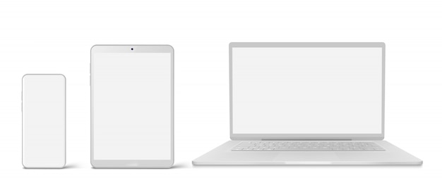 White laptop, tablet and phone with blank screen Free Vector