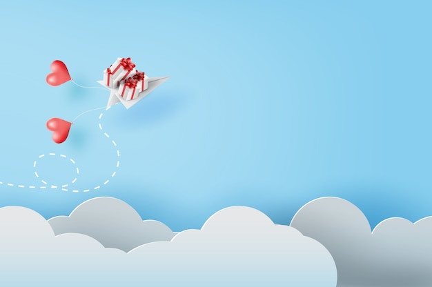 White paper airplanes with gift flying on sky Premium Vector