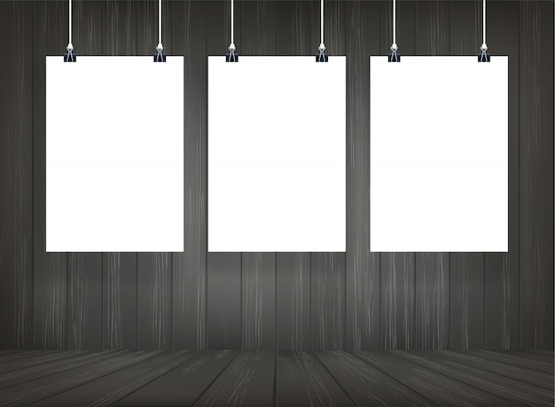 White paper poster hanging with wooden room space background. Premium Vector