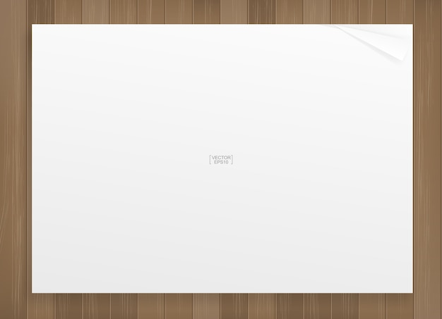 White paper sheet on wood texture background. Premium Vector