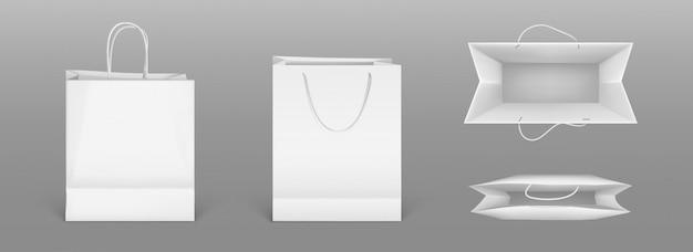 백서 쇼핑백 전면 및 상단보기입니다. 회색 배경에 고립 된 핸들 빈 패킷의 현실적인 모형. 상점 또는 시장을위한 골판지 가방에 기업 디자인을위한 템플릿 무료 벡터