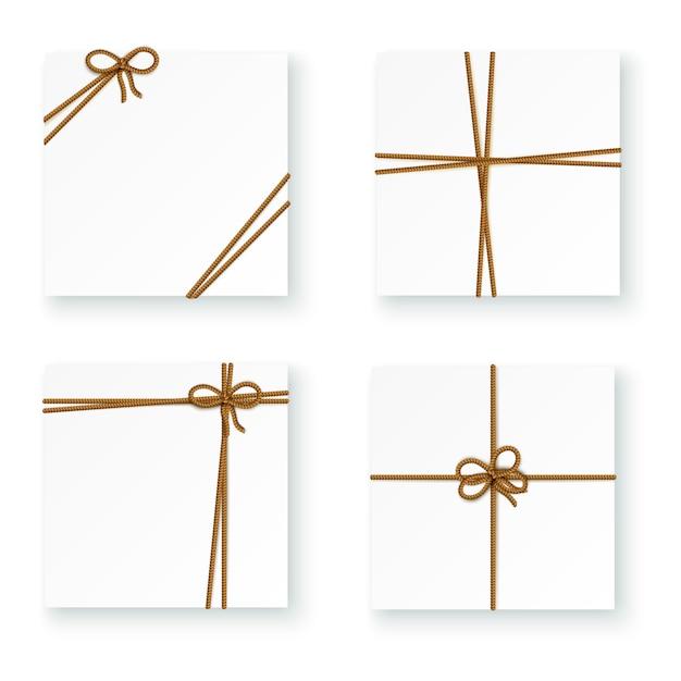 ロープコードの結び目を結ぶ白い小包パッケージボックス 無料ベクター