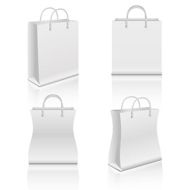 White realistic blank paper shopping bags set Premium Vector
