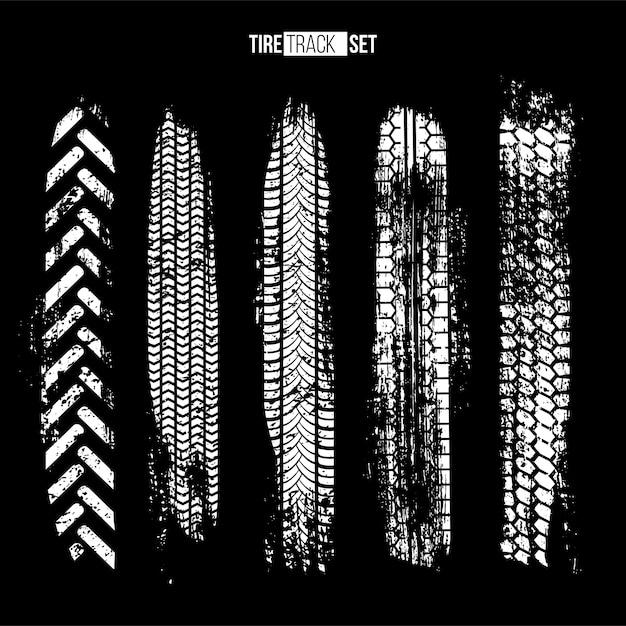 White tire track textures set on black background Premium Vector