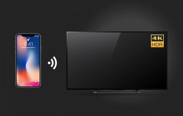 スマートフォンとwifiテクノロジを備えたリモート4kテレビ Premiumベクター