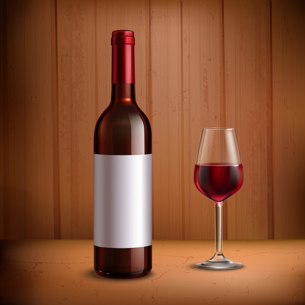 Wine bottle template with glass of red wine Free Vector