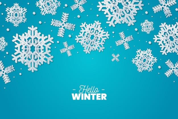 雪片と紙のスタイルの冬の背景 無料ベクター