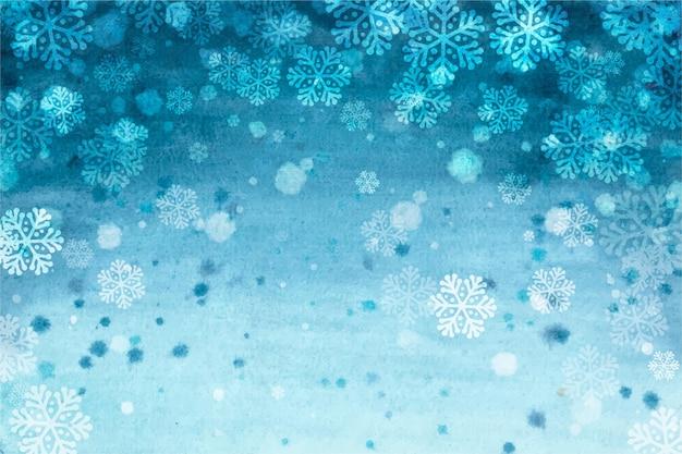 雪片と水彩風の冬の背景 無料ベクター