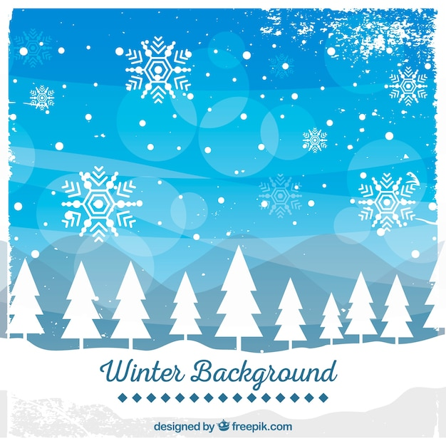 Winter background with a white forest