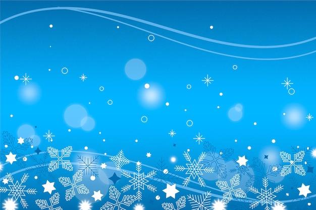 Sfondo invernale con fiocchi di neve sfocati Vettore gratuito