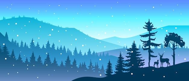 木々や鹿のシルエット、丘、雪片、山々と冬のクリスマスの森の風景 Premiumベクター