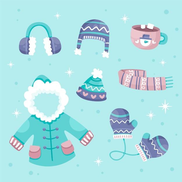 Winter clothes & essentials in flat design Free Vector
