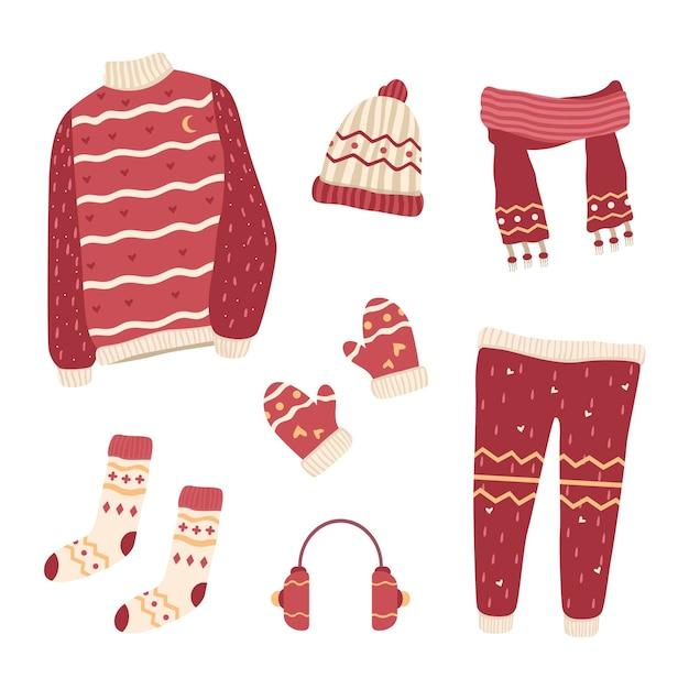 Vestiti invernali ed elementi essenziali in design piatto Vettore gratuito