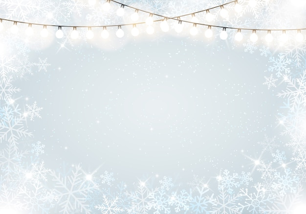 Winter frame with snowflakes and hanging fairy lights Premium Vector