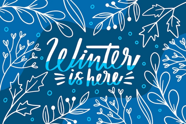 Winter is here text on blue background Free Vector