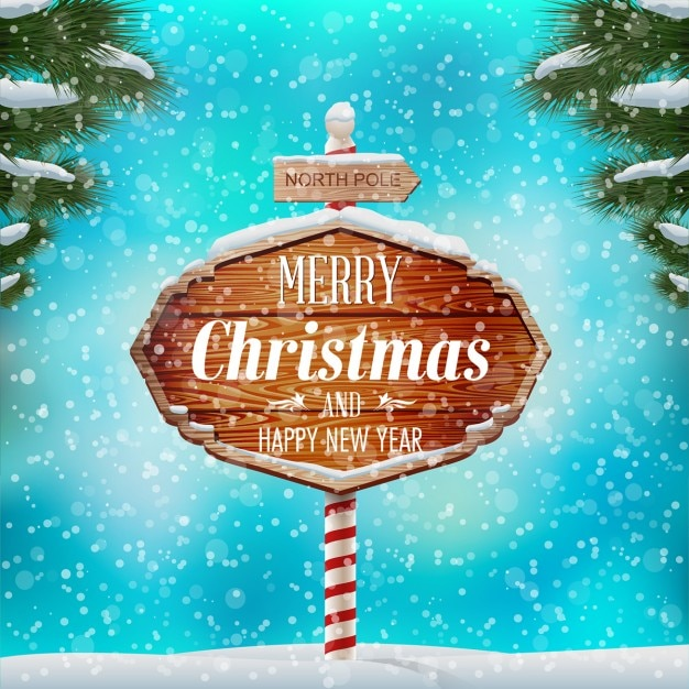 Winter landscape with christmas wood sign Free Vector