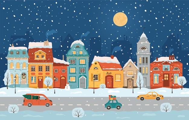 レトロなスタイルの冬の夜の街。クリスマスの背景。フラットなスタイルの居心地の良い街。 Premiumベクター