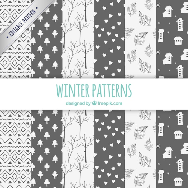 Winter patterns collection in hand drawn style Free Vector