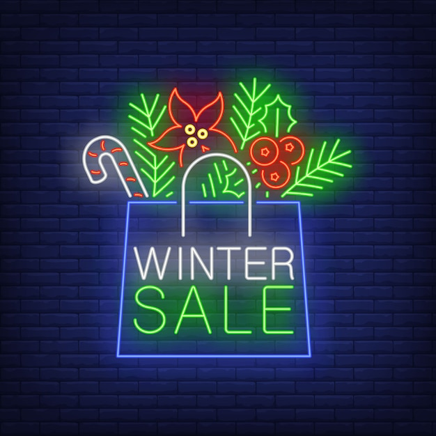 Winter sale banner, paper bag in neon style Free Vector