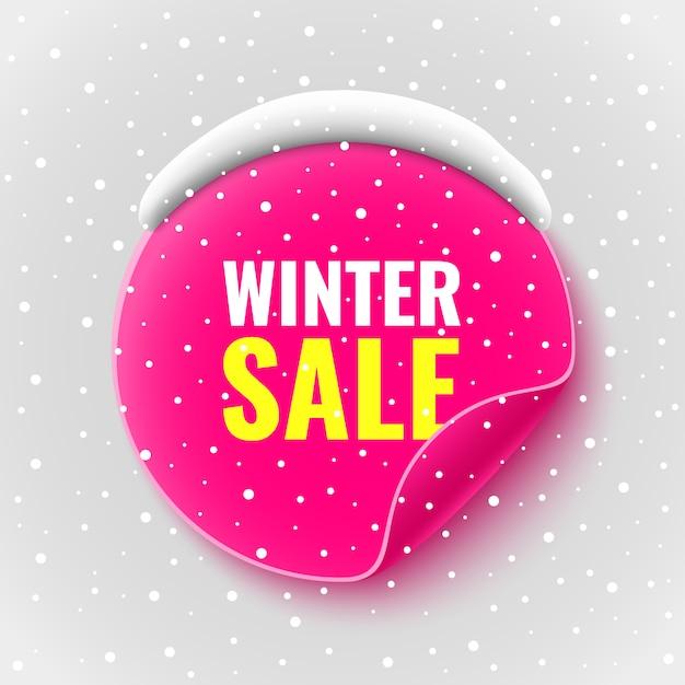 冬セールバナー。雪とピンクの丸いステッカー。図。 Premiumベクター