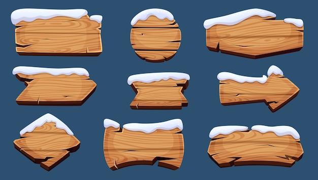 Winter signboards. wooden season banners with snow cap Premium Vector