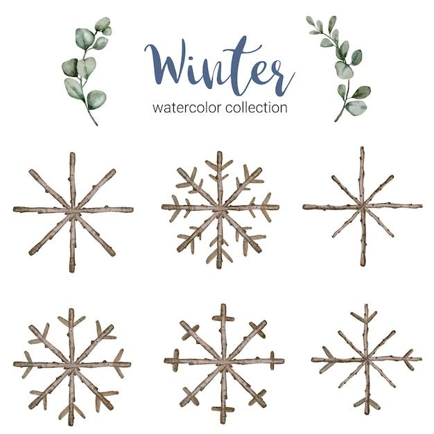 Коллекция зимних акварелей с ветвями, символизирующими прохладную зимнюю акварель. Бесплатные векторы