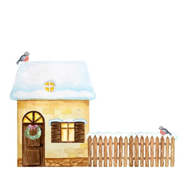 冬の黄色い家、雪とウソの鳥のカップルと茶色の木製のフェンス。水彩正面図。 Premiumベクター