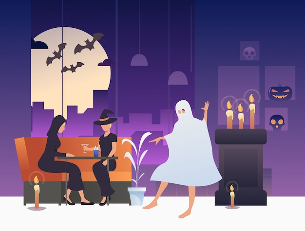 Witches drinking cocktails while ghost dancing in bar Free Vector