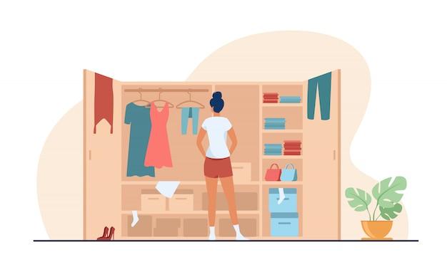 Женщина, выбирая платье из гардероба плоской иллюстрации Бесплатные векторы