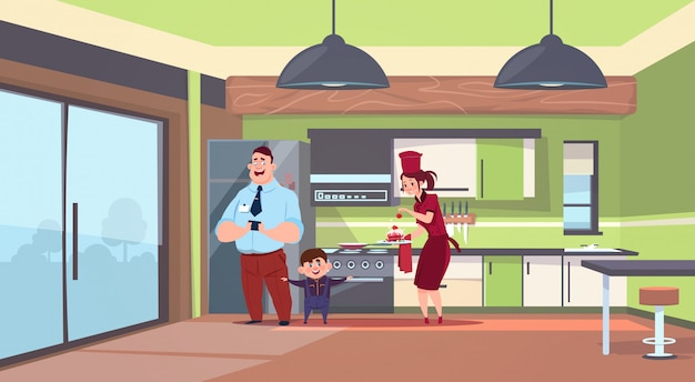 Woman in cook uniform giving cake to man and boy in modern kitchen background Premium Vector