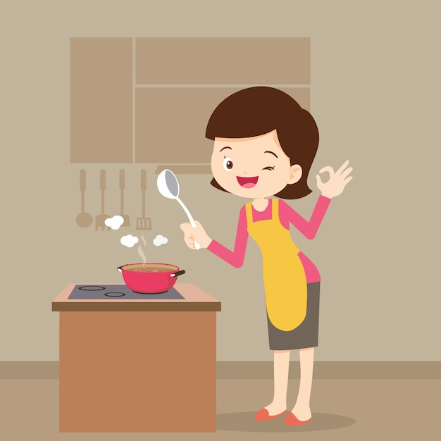 Woman cooking showing ok sign Premium Vector