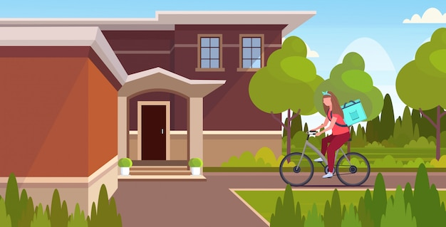 Woman courier with large backpack riding bike delivering food from shop or restaurant express delivery service concept modern villa house landscape background  horizontal full length Premium Vector
