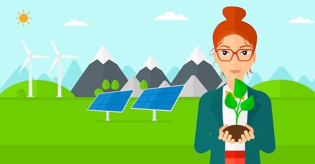 Woman holding plant Premium Vector