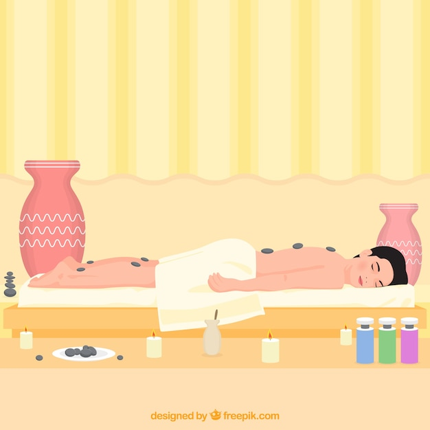 Woman in spa with stone treatment
