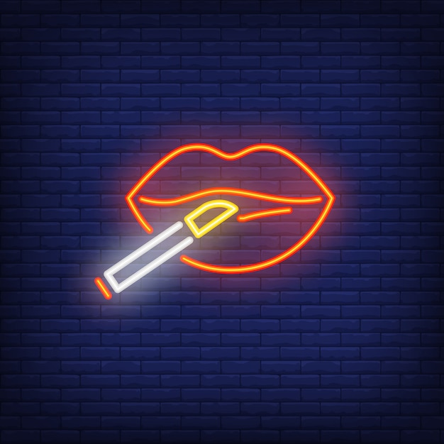 Woman lips with cigarette neon sign Free Vector