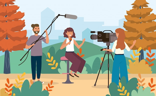 Woman reporter with  camera woman and  camera man with camcorder and microphone Premium Vector