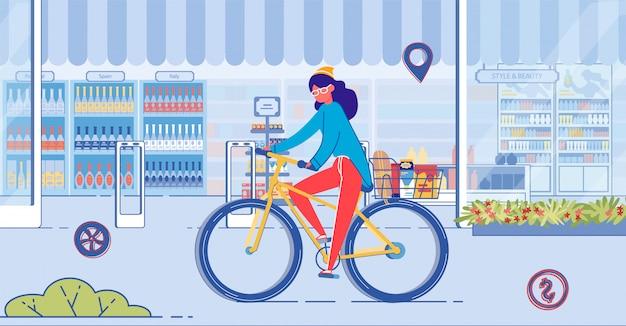 店の窓が付いている通りに自転車に乗る女性 Premiumベクター