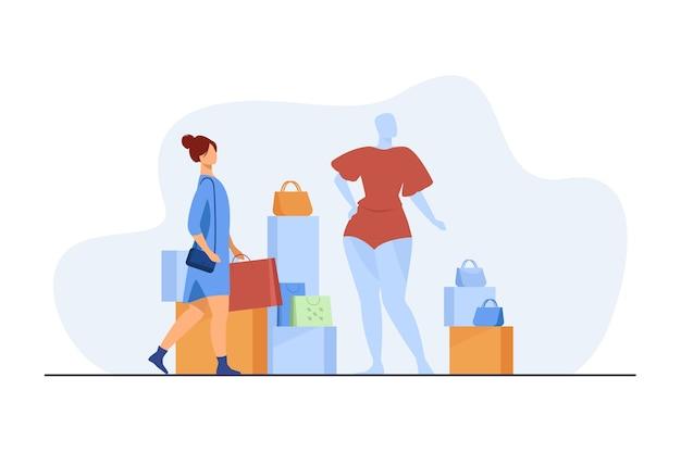 ファッション店で買い物をする女性。バッグ、マネキン、アクセサリーフラットベクトルイラストをお持ちのお客様。消費主義、消費者、衣服購入の概念 無料ベクター
