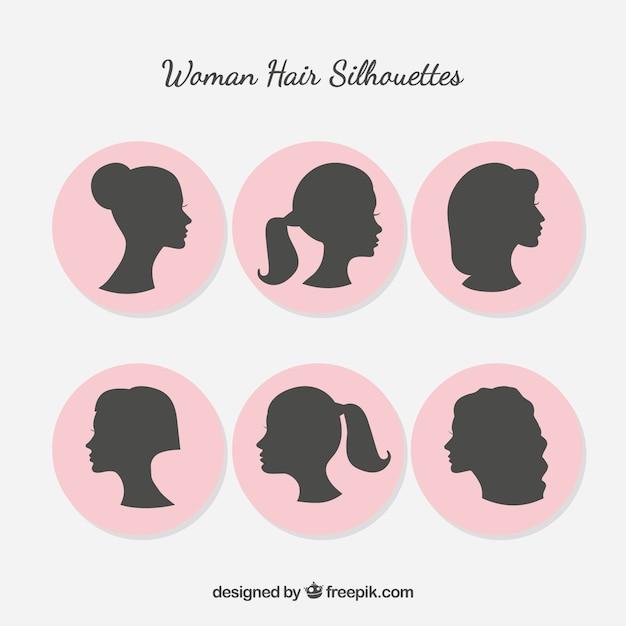Женщина силуэт с укладки волос Premium векторы