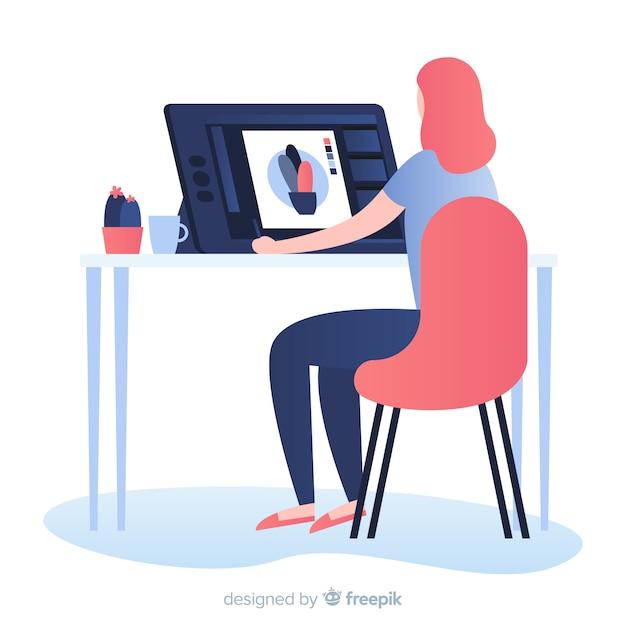 Donna che si siede al posto di lavoro del progettista grafico Vettore gratuito