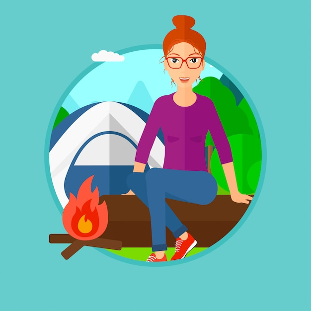 Woman sitting on log in the camping. Premium Vector