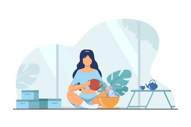 床に座って植物に水をまく女性。家、水、葉フラットベクトルイラスト。趣味と家の庭のコンセプト 無料ベクター