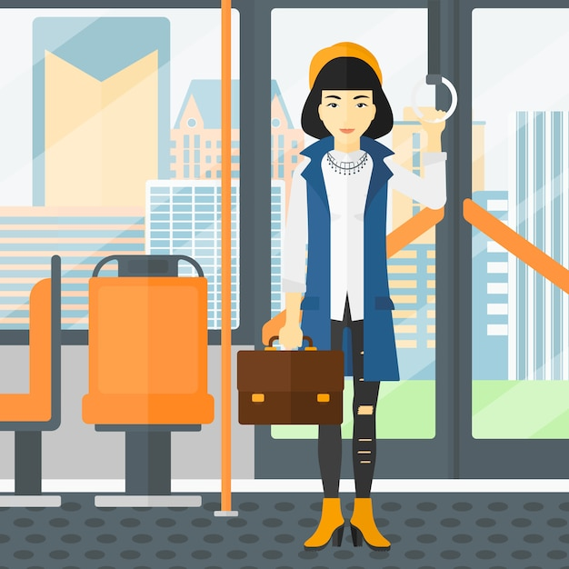 Woman standing inside public transport. Premium Vector