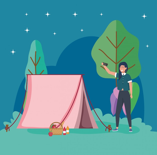 Woman taking selfie night tent camping picnic Premium Vector