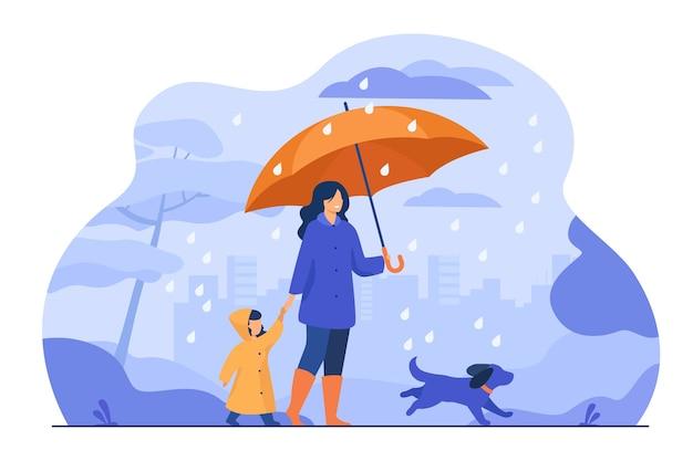 Женщина с зонтиком, девушка в плаще и собака гуляют под дождем в городском парке. векторная иллюстрация для семейной деятельности, плохая погода, концепция ливня Бесплатные векторы